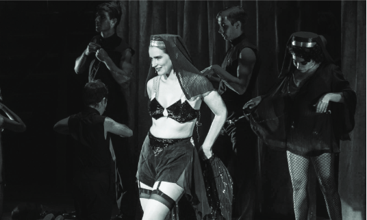 """Amy Griffin SC '18, playing Sally Bowles, and the Kit Kat boys and girls perform """"Don't Tell Mama"""" in the """"Cabaret"""" dress rehearsal on Oct. 24. Photo courtesy of Meghan Joyce, the Student Voice."""