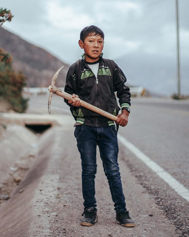 Took this portrait of this little boy at 6 am in Urubamba, Peru. He said he was dropping some tools for his sister. Rising and shining, hardworking little man.  #peru #portrait #maras #sunrise #sacredvalleyoftheincas #quechua
