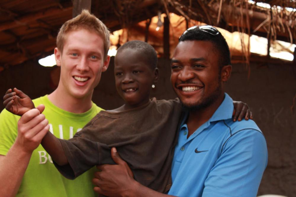 First picture taken with Emma in the slum of Masese  From left to right: Robbie, Emma, Raoul