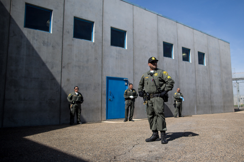 Guards prepare to search inmates in the prison's general population before they come out on the prison yard.The prison has more than 2,000 employees to care for a population of 4,386 inmates.