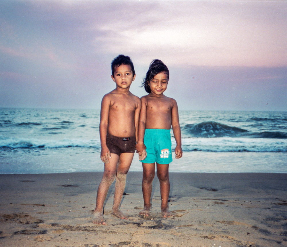 Azad and Nahela on the beach in Negombo, Sri Lanka.