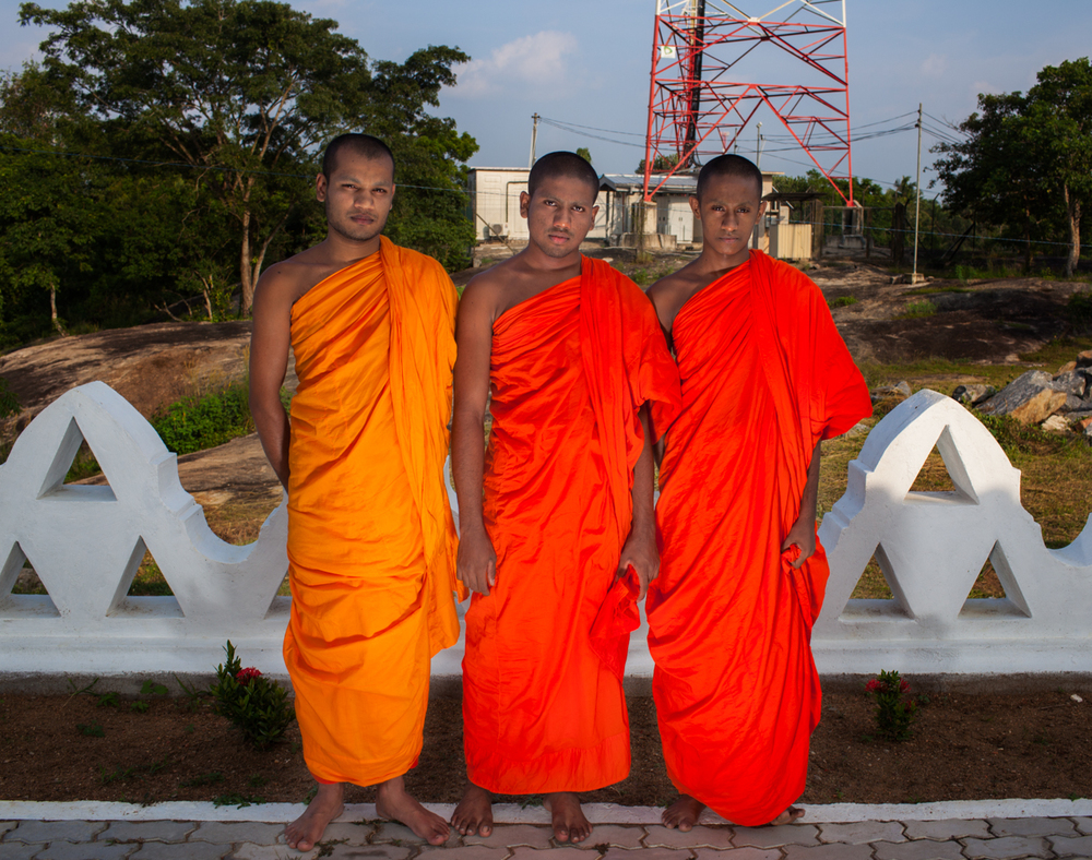 Monks outside a monastery where they study and pray in Nikaweratiya, Sri Lanka.