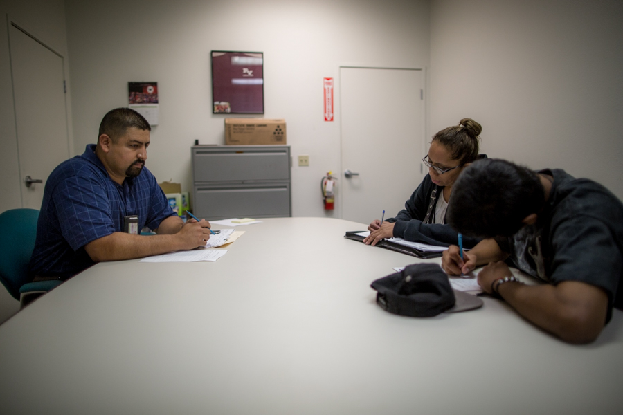 Damian signs the terms of his probation with his officer at the county offices in Pomona. He is supposed to stay away from drugs, seek employment, rack up high school credits and get counseling for anger issues.