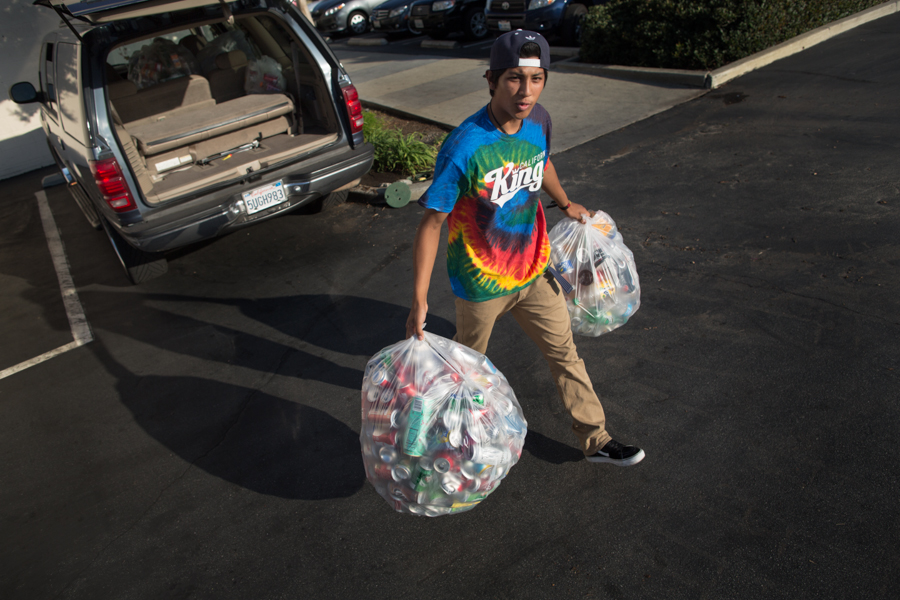 Damian takes all his family's cans and bottles from his entire six-month stay in camp to a recycling center. He's hoping to get more than $100 for the stash, but it's only worth about $60.