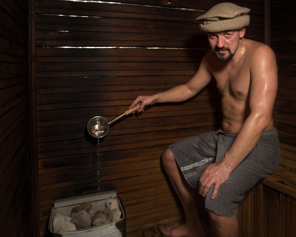 Dmitry Vinnick pours water on the scalding rocks of a steam bath. Vinnick is a philosophy professor writing about the moral and ethical implications of technological innovation.