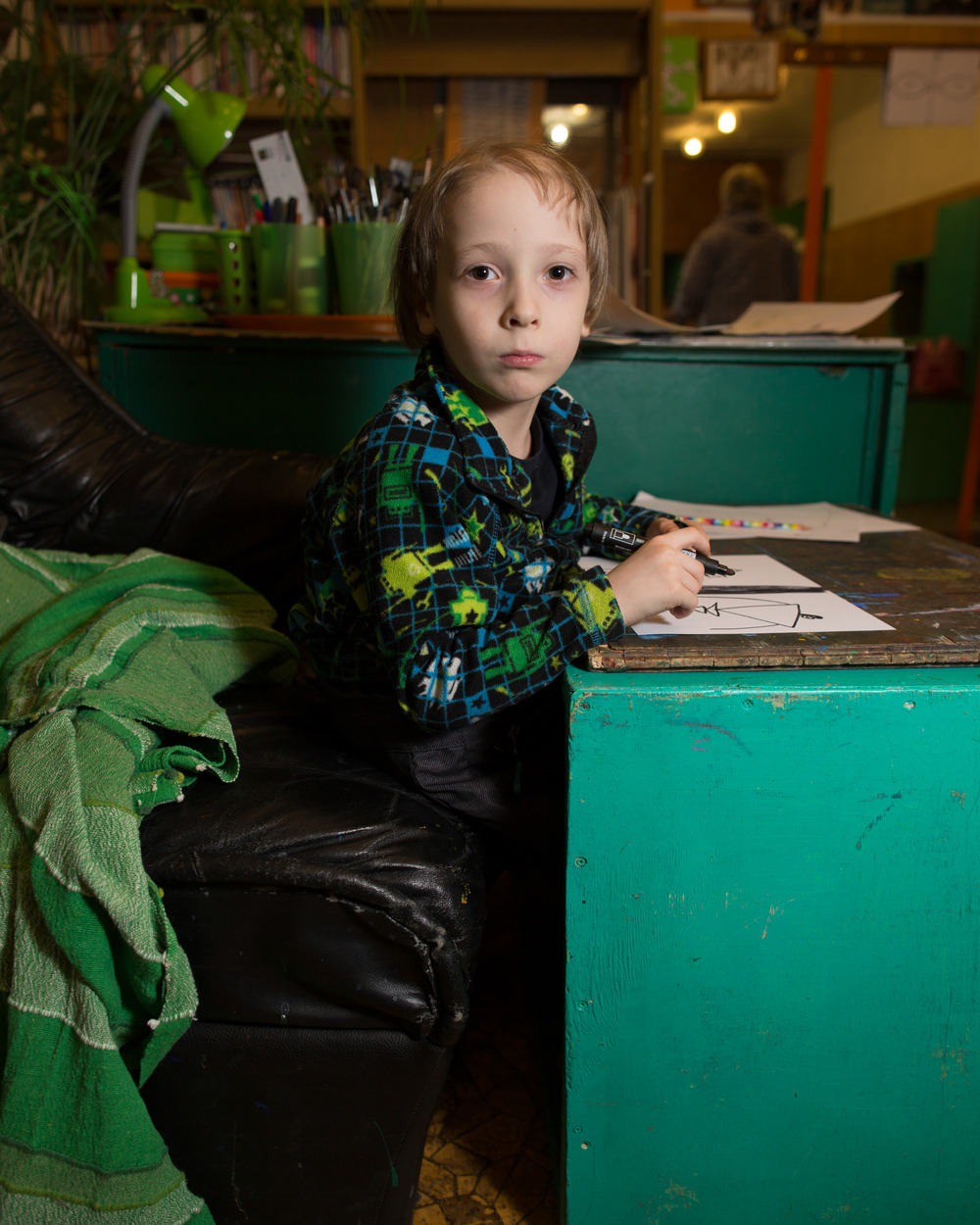 Nikita Sokolov, 6, draws frames for a cartoon he is conceiving. The daycare and movie studio where he plays is inside the first building ever built in Akademgorodok, before the town's official beginnings in 1957.