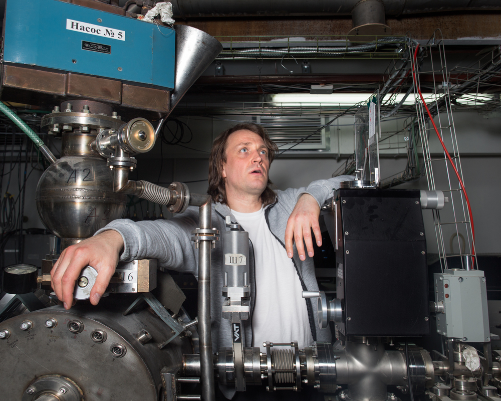 Anton Nikolenko makes adjustments to a particle collider that he uses for experiments at the Institute of Nuclear Physics.