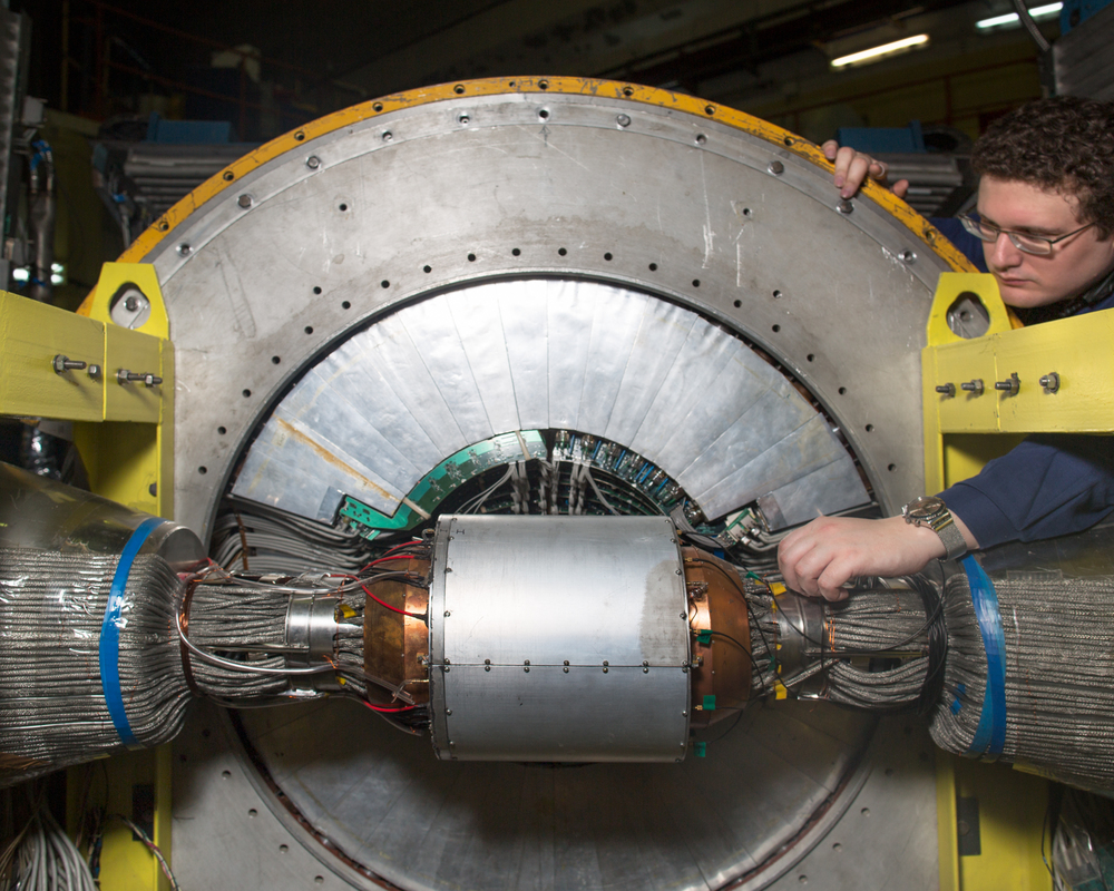 Ilya Surin repairs a collider in the Institute of Nuclear Physics.