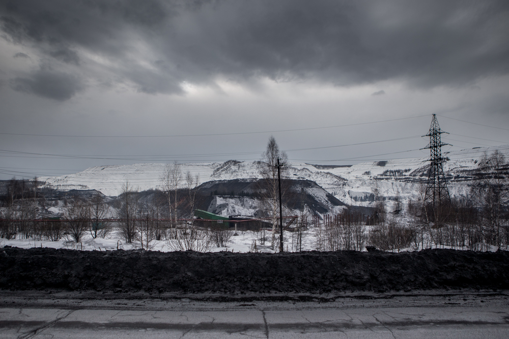 The Kuznetsk Basin is Russia's largest source of coal and the traditional home of several native Turkic tribes. Open pit coal mines, like this one outside the village of Chuvashka, surround their villages.