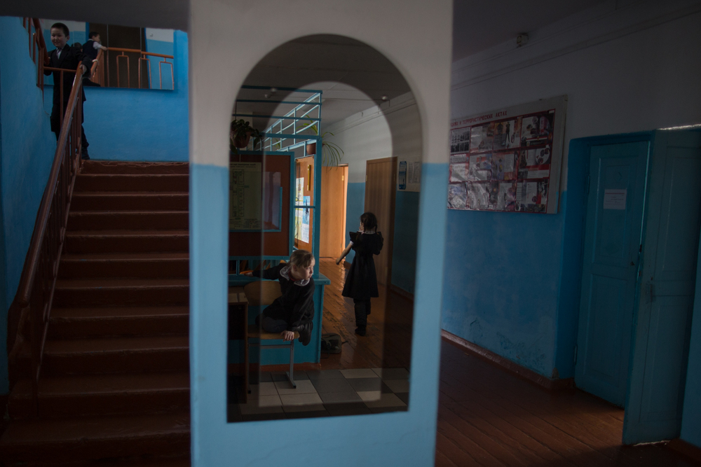 Students wander the halls of the main school in the small town of Bekovo, Russia, where they teach the local native language of Teleut.