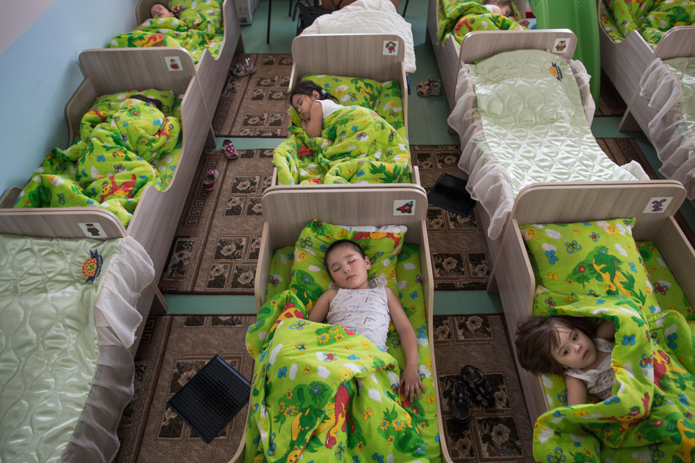 "Children sleep in a nap room at the newly constructed kindergarten, ""Planet of Childhood,"" in the small town of Bekovo."