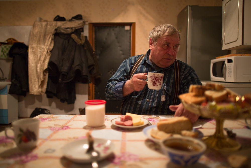 Kostya drinks tea in a suburb of Novokuznetsk.