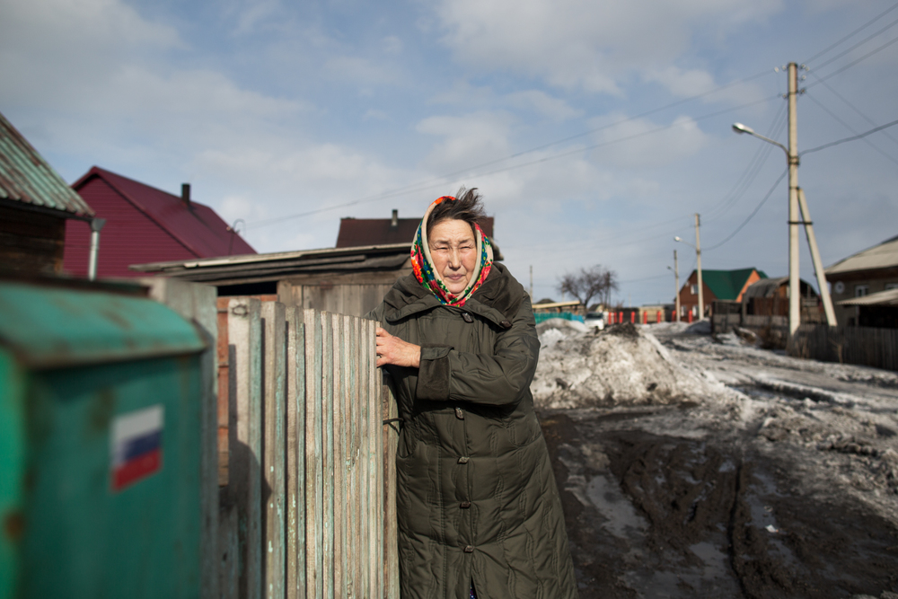 Anna Tadykova leaves her home in a Teleut village near Novokuznetsk.