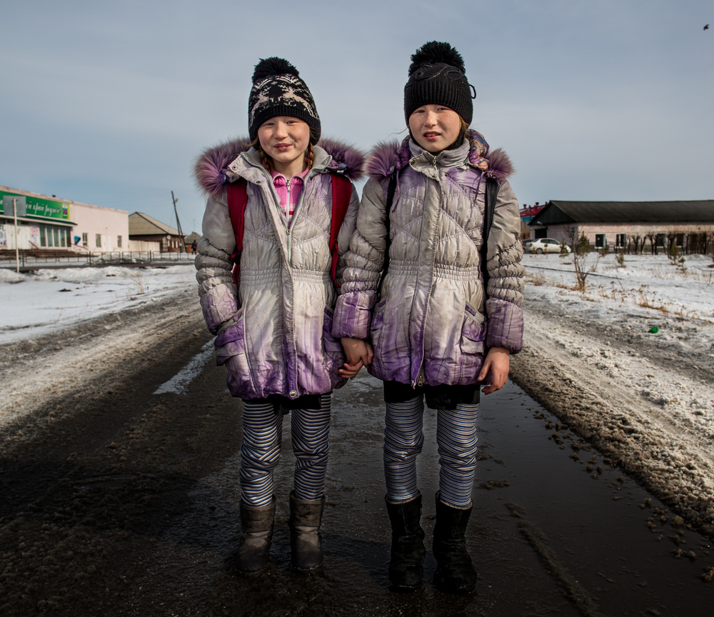Twins Katya and Nadya after school in Bekovo, Russia.