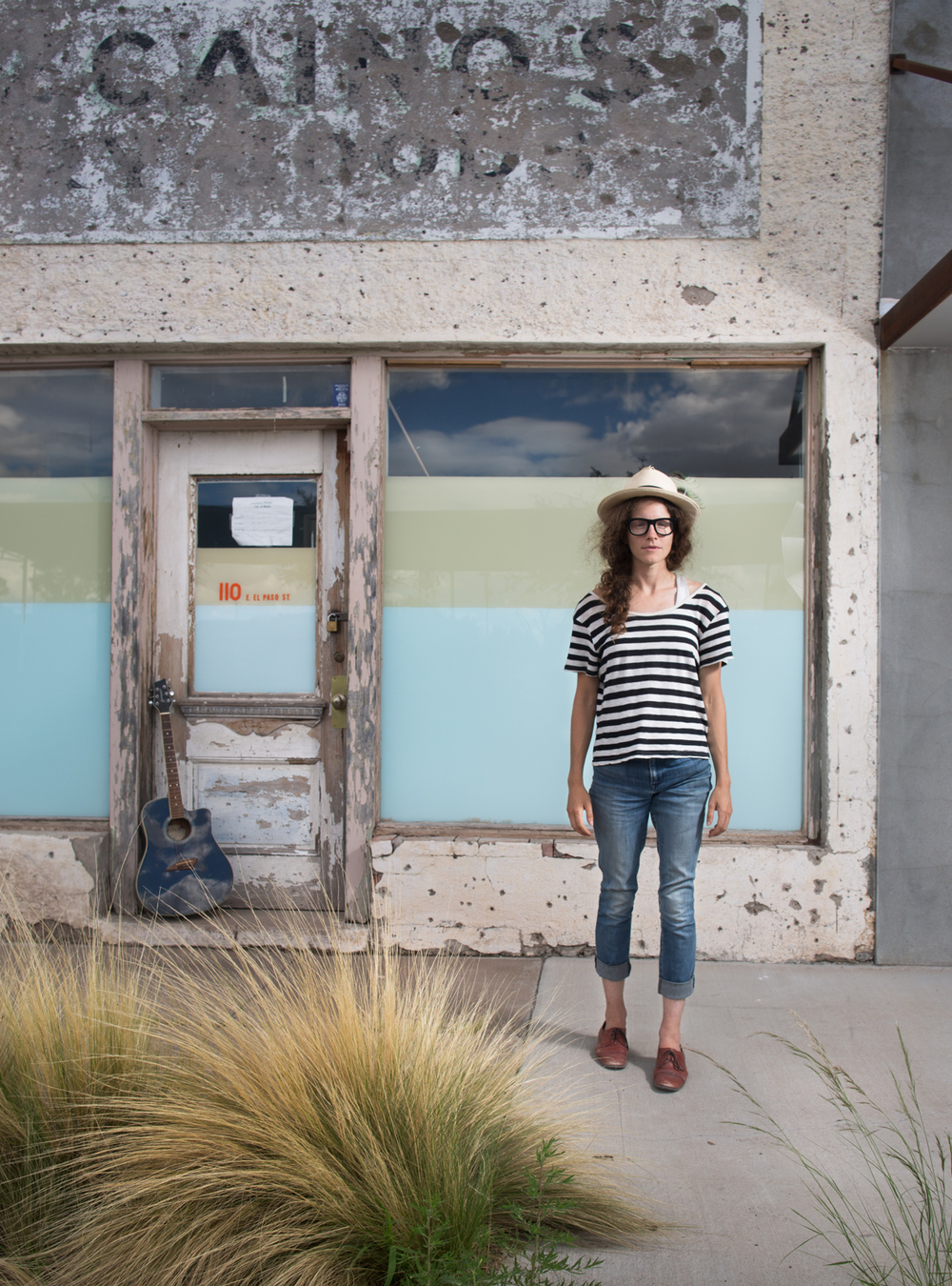 Zoey with her guitar in Marfa, Texas.