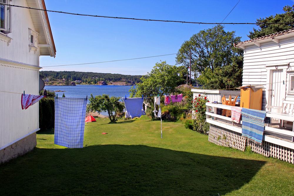 Det er herlig å rusle blant villaene på Sanne og kjenne duften av syriner og klesvask til tørk i forsommersola.