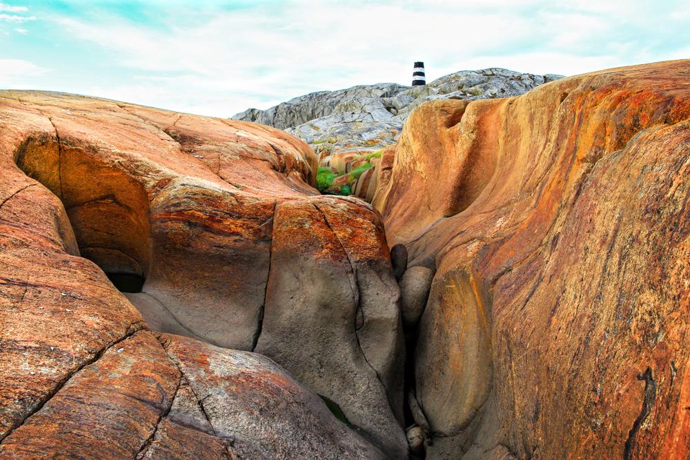 Det kjente sjømerket Linnkleppen rager stolt over ra-landskapet på Herføl.