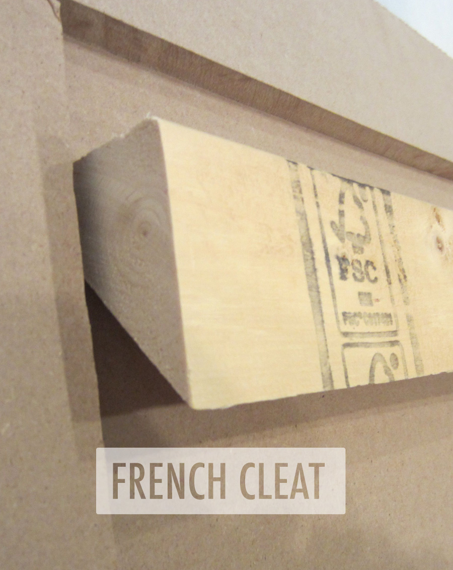 A French cleat is attached to hang the DIY upholstered headboard