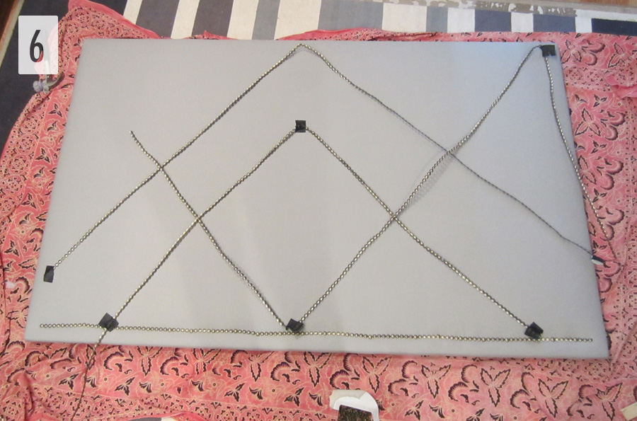 Step 6: Lay out the nailhead trim for your upholstered headboard in the design you want to achieve