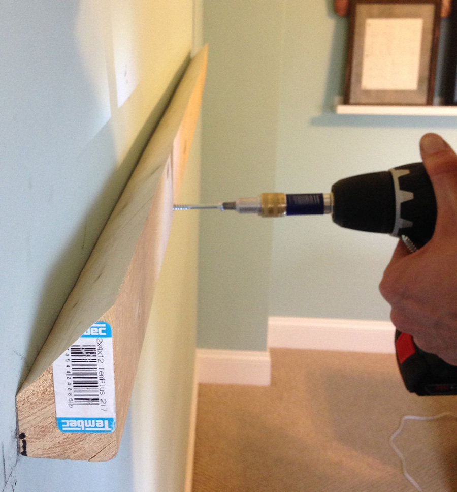 Step 8: Attach the other half of the French cleat to the wall to hang your upholstered headboard