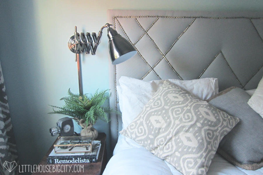 DIY tutorial for building a West Elm knock-off upholstered headboard with decorative nailhead trim