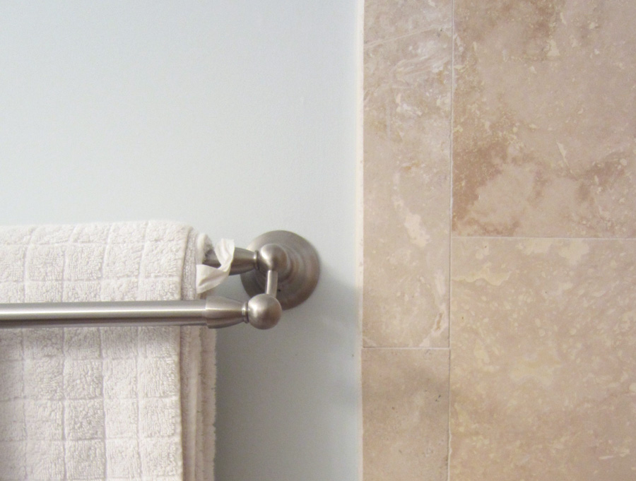 I chose a simple three-color palette to minimize visual noise in our small master bathroom