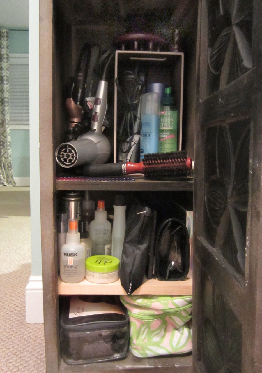 Storage for hair products is made easier with compartments in the vanity.