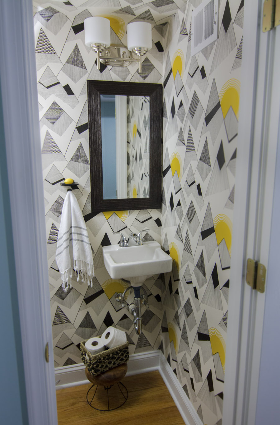 "Wallpaper is ""Mountains"" by Miss Print courtesy of Wallpaper Direct, soap dish & hook are from Signature Hardware, and mirror is from Homegoods"