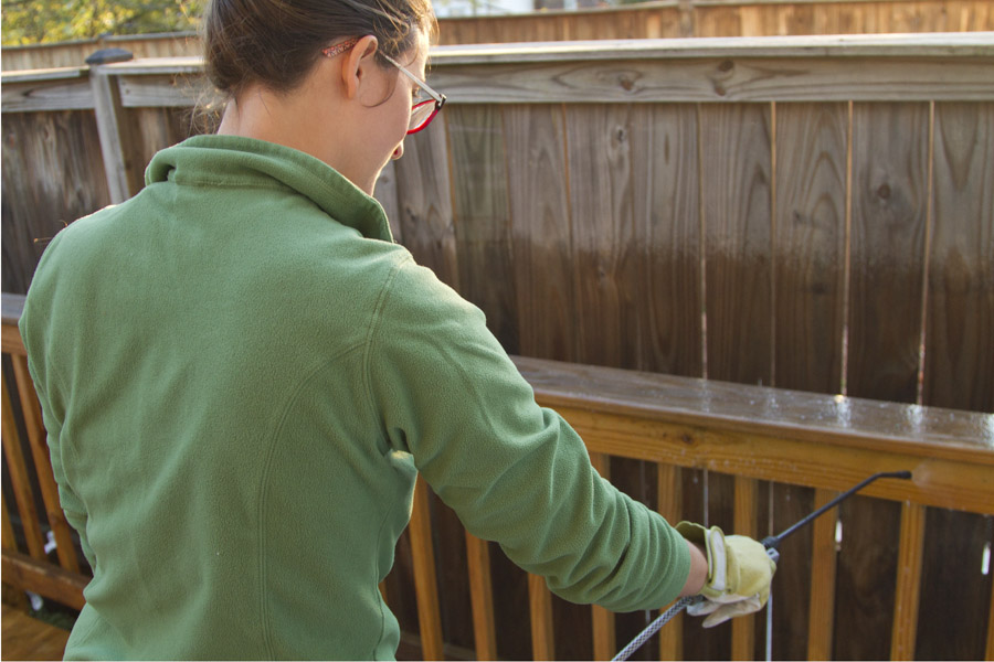 Step 2: Spray Behr Premium all-in-one wood cleaner over the deck