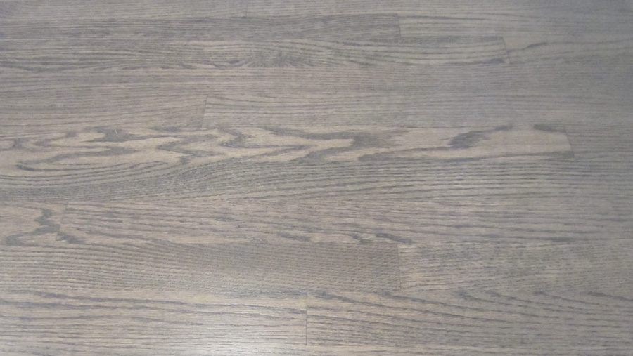 Close up of the floors after refinishing them. They're a mix of Coffee Brown from DuraSeal and Classic Gray by Minwax.