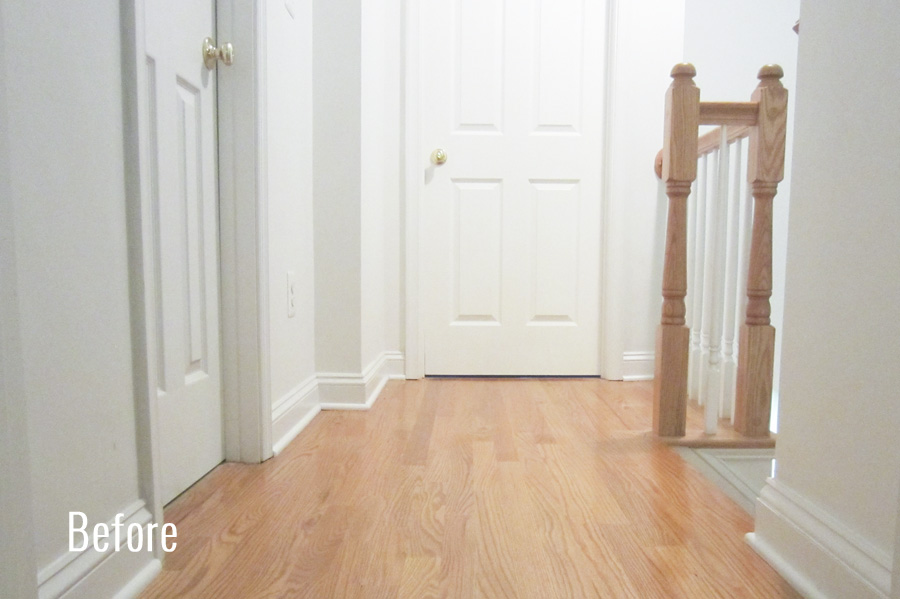 The hallway with natural oak floors
