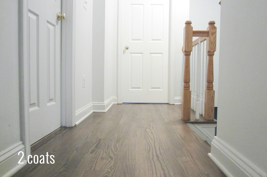 The upstairs hallway after 2 coats of stain on the floors