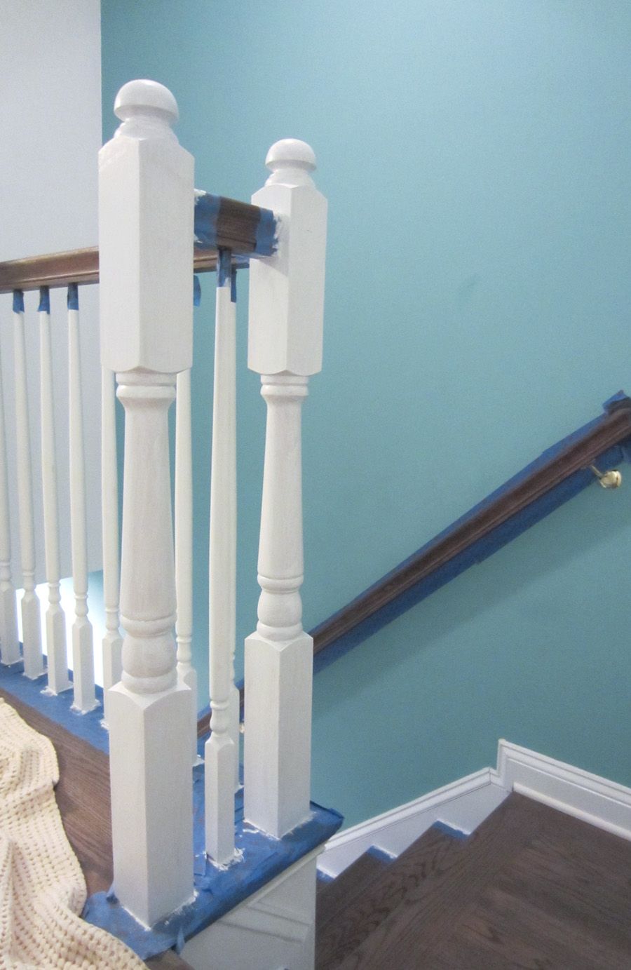 I applied 3 coats of white semi-gloss paint to the stairwell posts