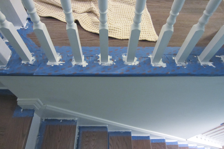 I touched up the base of the balusters and around the stair treads