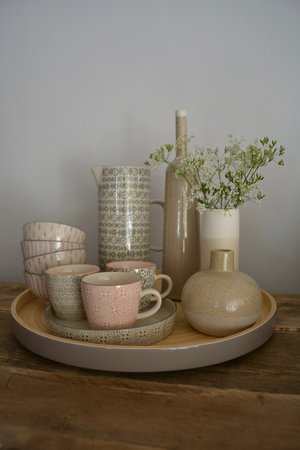 Grey lacquer bamboo tray £36 | Grey patterned serving dish £9.99 | Patterned tea-cup £6.95 | Bowls assorted patterns £5.95 | Tall stem vase £17.85 | Two-tone slimline vase £10.95 | Bubble stem vase £12.99