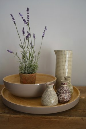 Grey lacquer bamboo tray £36 | Grey lacquer bamboo bowl £26 | Artificial lavender plant £22.99 | Tall pouring jug £24.95 | Individual bottle vases £6.95 each