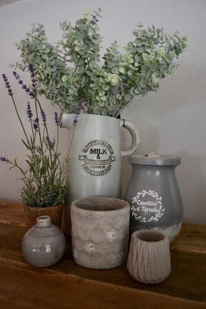 Tall Milk jug £44.95 | Artificial lavender plant £22.99 | Italian style grey pot with lid £34.99 |  Honeycomb and bee stone planter £10.99 | Concrete geometric tea light holder £7.95 | Grey glazed bottle vase £8.99