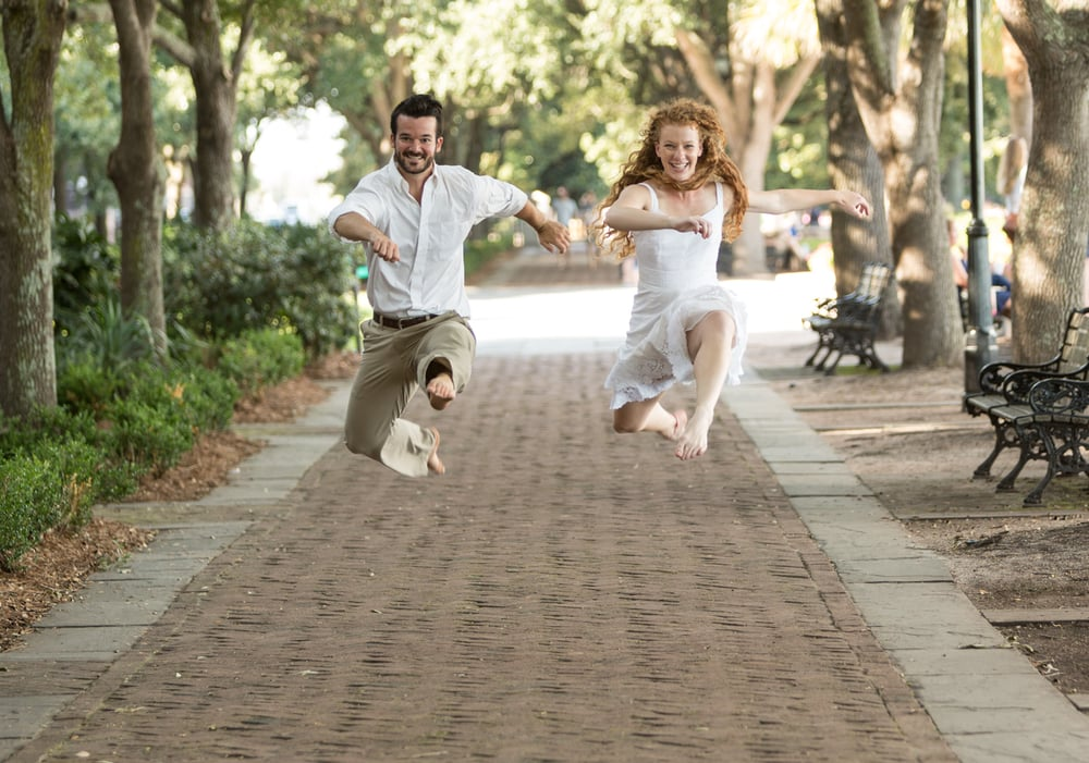 Paul and Emily leaping during a fun photography session