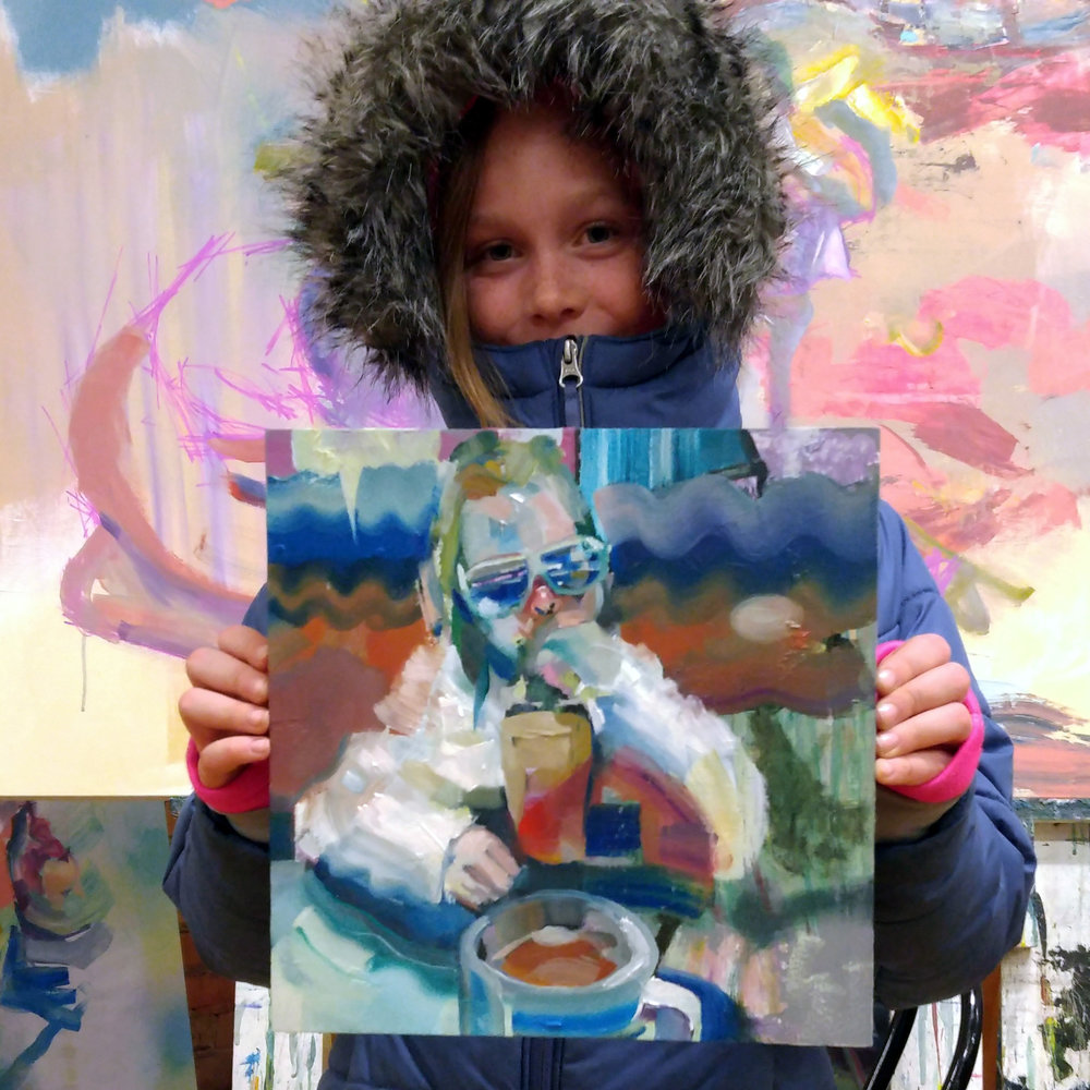 My daughter holding a painting I made of her.  She is my most constant model for my paintings.