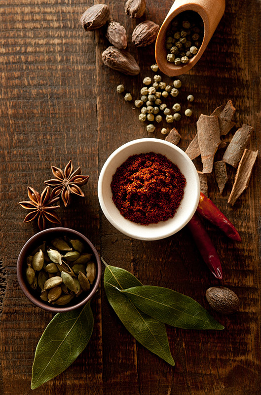 Pepper Corns, Cinnamon, Chili, Cardamom, Star Anise, Nutmeg and Bay Leaves Spices Food Stock Photo