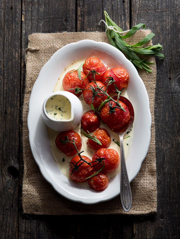Roasted Tomatoes with Tarragon Cream Sauce Food Stock Photo