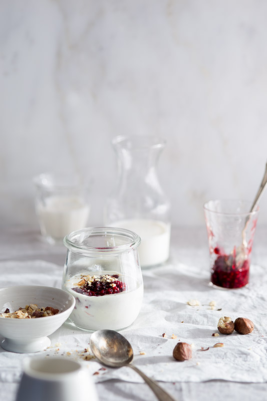 Breakfast with Yogurt, Jam, Nuts and Milk Stock Food Photo