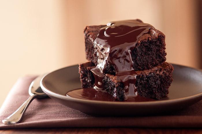 Chocolate Brownie with Chocolate Sauce Stock Food Photo