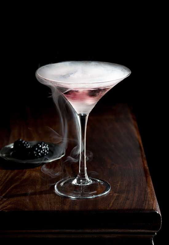 Blackberry Gin Cocktail with Dry Ice Drink Stock Photo