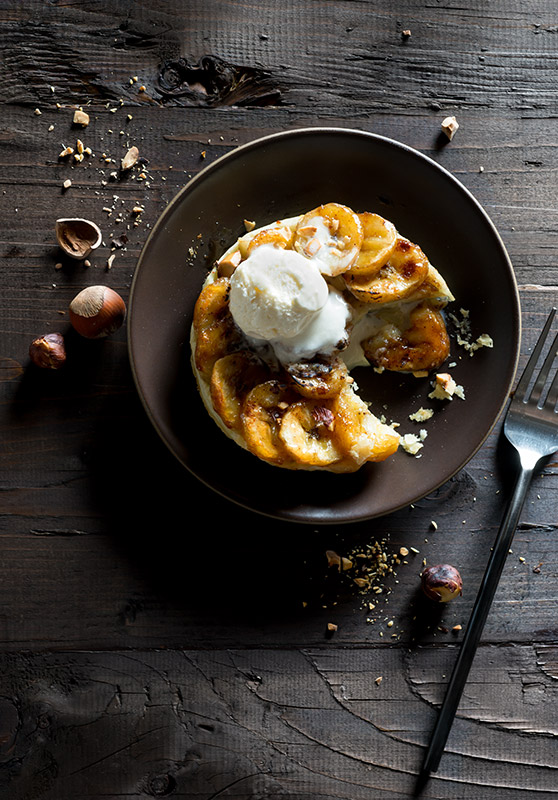 Banana Tarte Tatin with Toasted Hazelnuts and Ice Cream Stock Food Photo