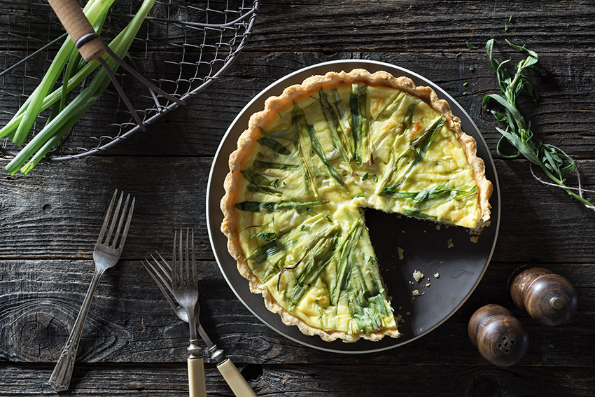 Tarragon Garlic–Infused Green Onion Goat Cheese Quiche Stock Food Photo