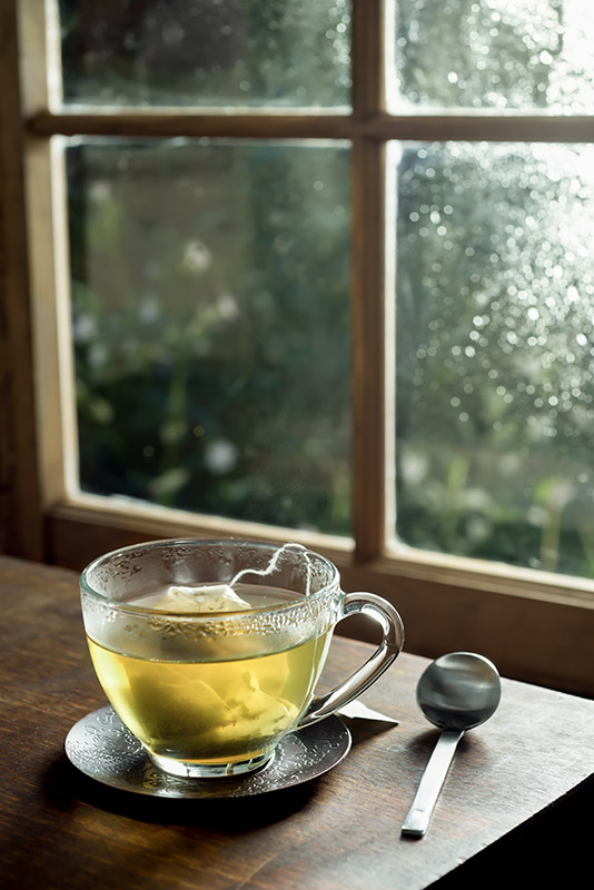 Hot Green Tea in a Tranquil Setting Stock Photo