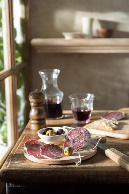 Salami and Red Wine in a Rustic Farmhouse Stock Photo