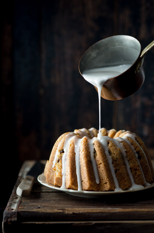 Bundt Cake Being Glazed Stock Food Photo
