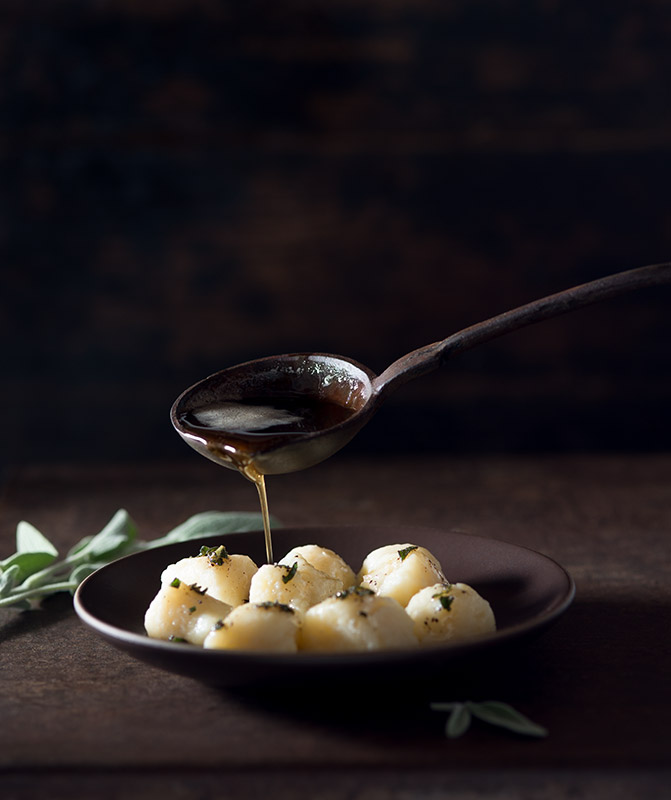 Pouring Brown Butter on Potato Gnocchi Stock Food Photo